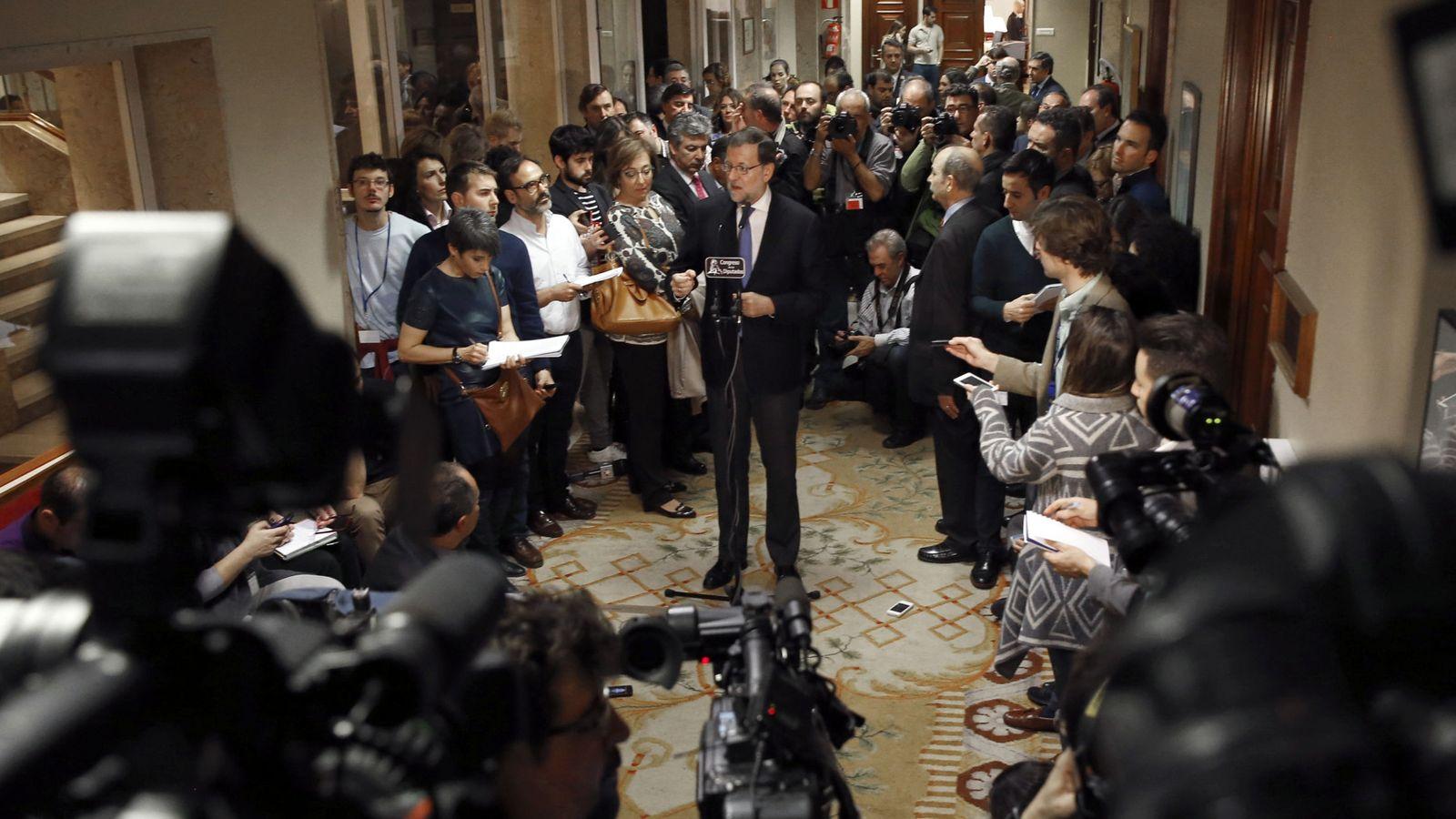 Foto: Mariano Rajoy, tras recoger este domingo su acta de diputado en el Congreso de los Diputados. (EFE)