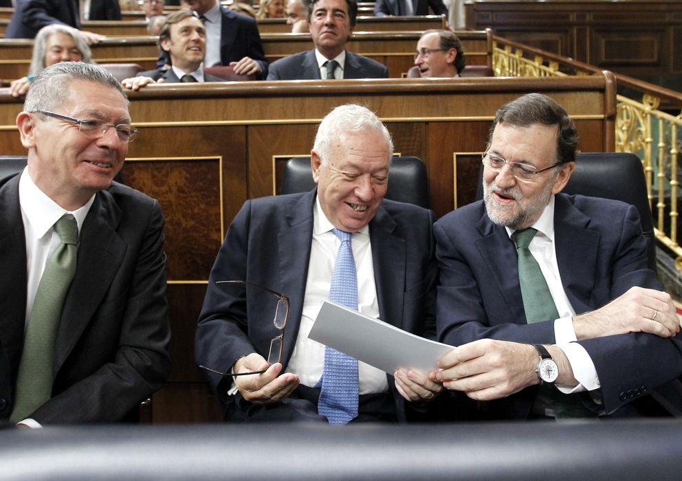 Foto: El ministro de Justicia, Alberto Ruiz-Gallardón (i), el ministro de Asuntos Exteriores, José Manuel García-Margallo (c), y el presidente del Gobierno, Mariano R