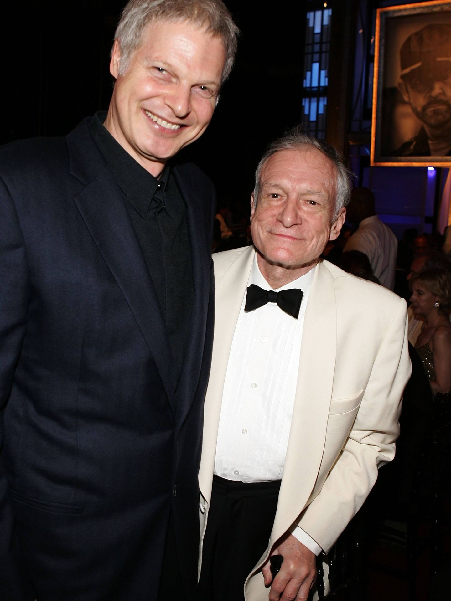 Bing, junto a Hugh Hefner en 2006. (Getty)