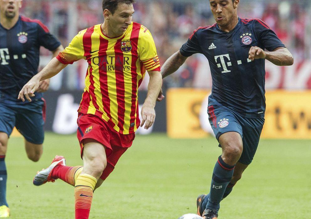Foto: Thiago y Messi, en el partido del Allianz (Efe).