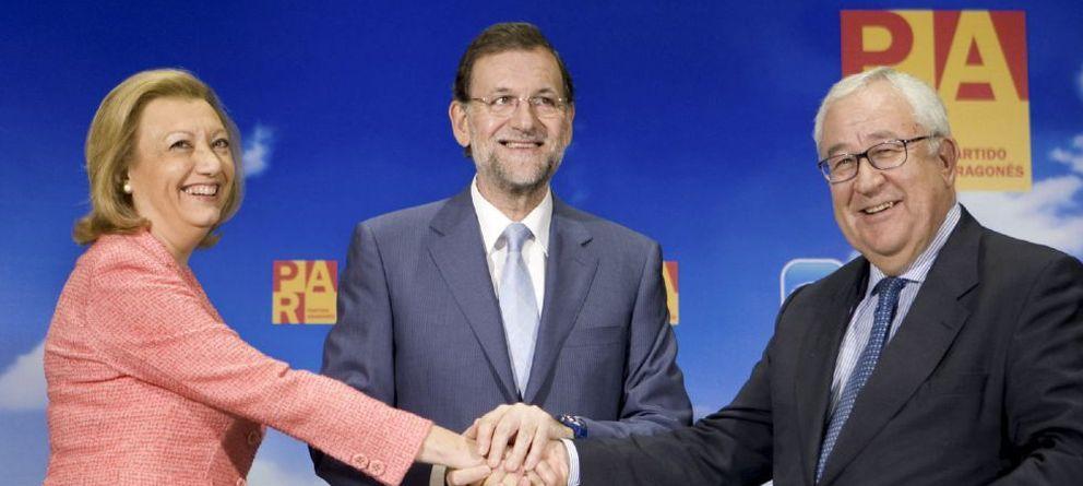 Foto: Luisa Fernanda Rudi, Mariano Rajoy y José Ángel Biel. (Efe)
