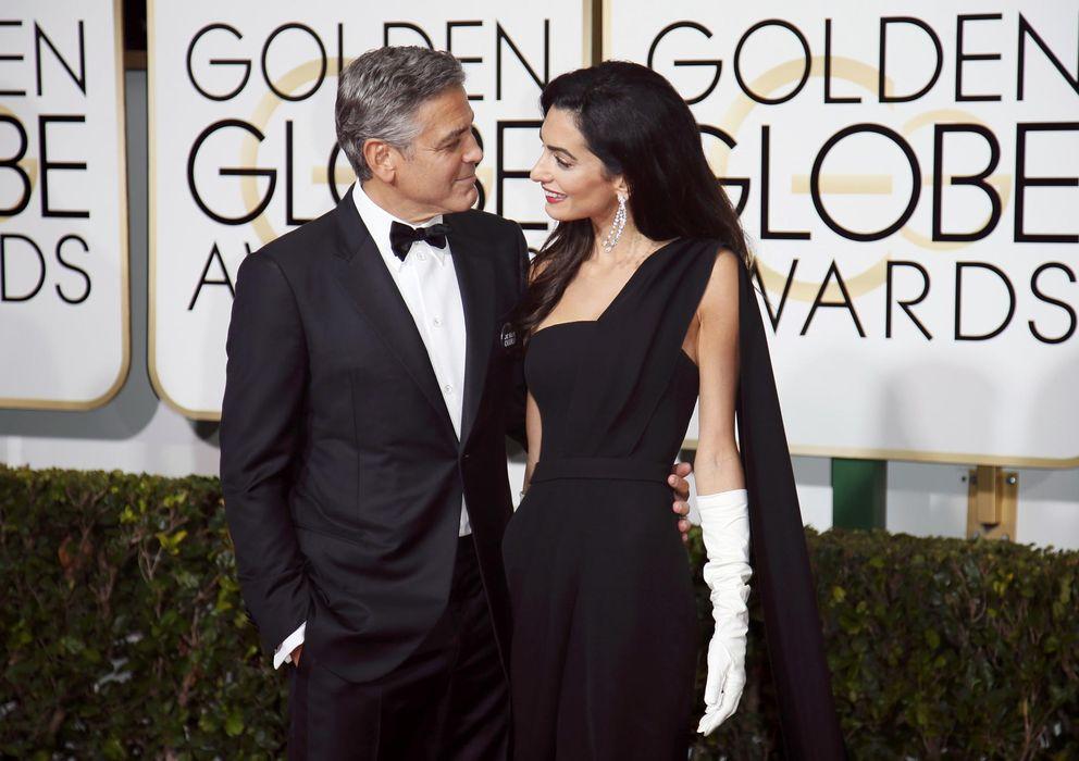 Foto: George Clooney y Amal Alamuddin este domingo en los Globos de Oro (Reuters)