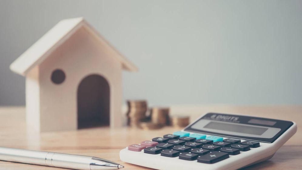 Foto: Vivo en el extranjero y he comprado casa en España para alquilar, ¿qué impuestos pagaré? (iStock)