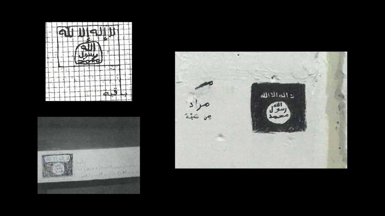 Inscripciones de la bandera del Daesh halladas en prisión.