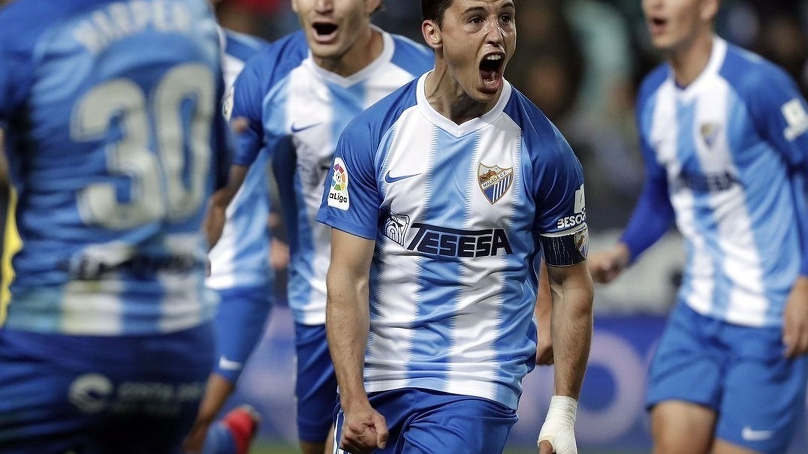 Foto: Jugadores del Málaga celebran un gol. (Europa Press)