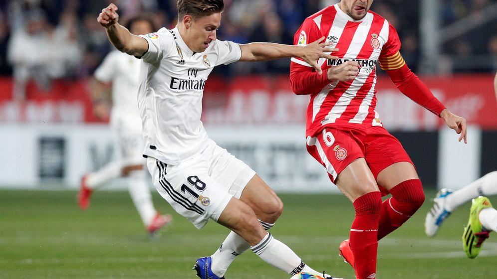 Foto: Marcos Llorente, con la camiseta del Real Madrid en un encuentro contra el Girona. (Reuters)