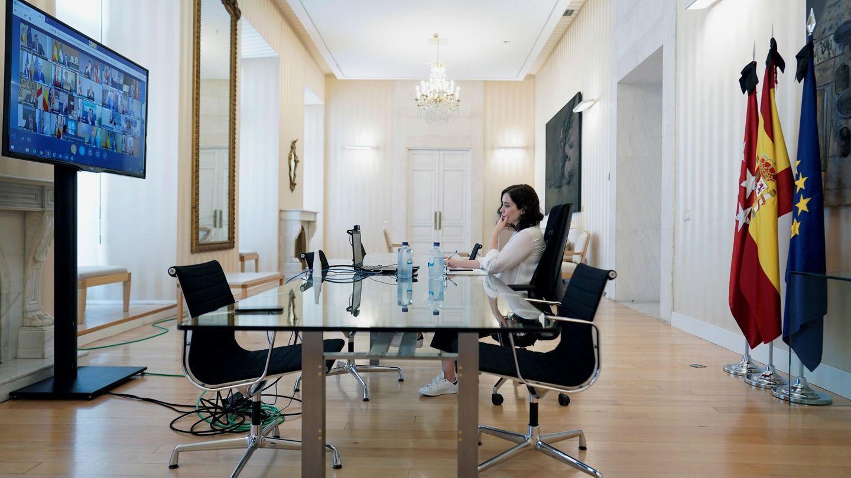 La presidenta de la Comunidad de Madrid, Isabel Díaz Ayuso, durante la videoconferencia convocada por el Gobierno central con las Comunidades Autónomas. (EFE)