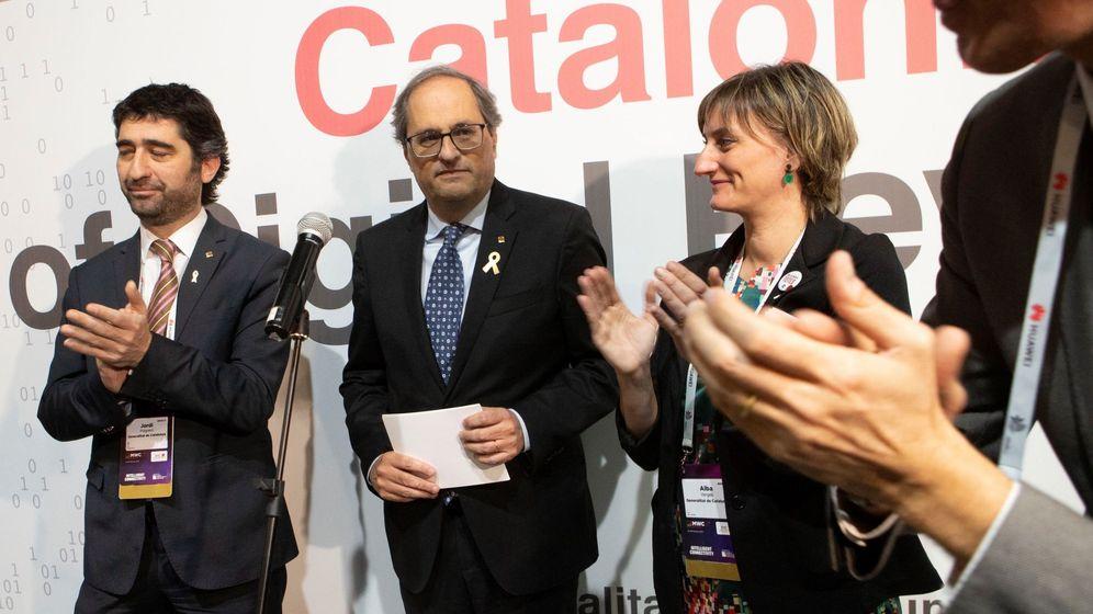 Foto: Jordi Puigneró y Quim Torra, en el Mobile. (EFE)