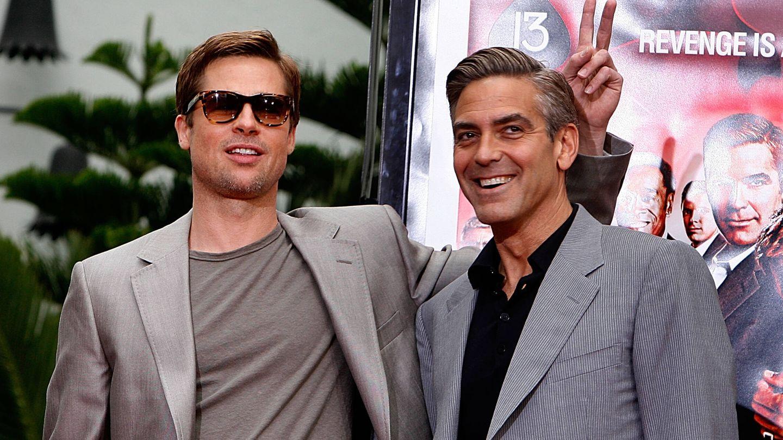 Brad Pitt y George Clooney. (Getty)