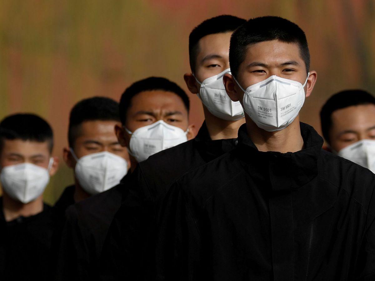 Foto: Personal de seguridad chino. (Reuters)