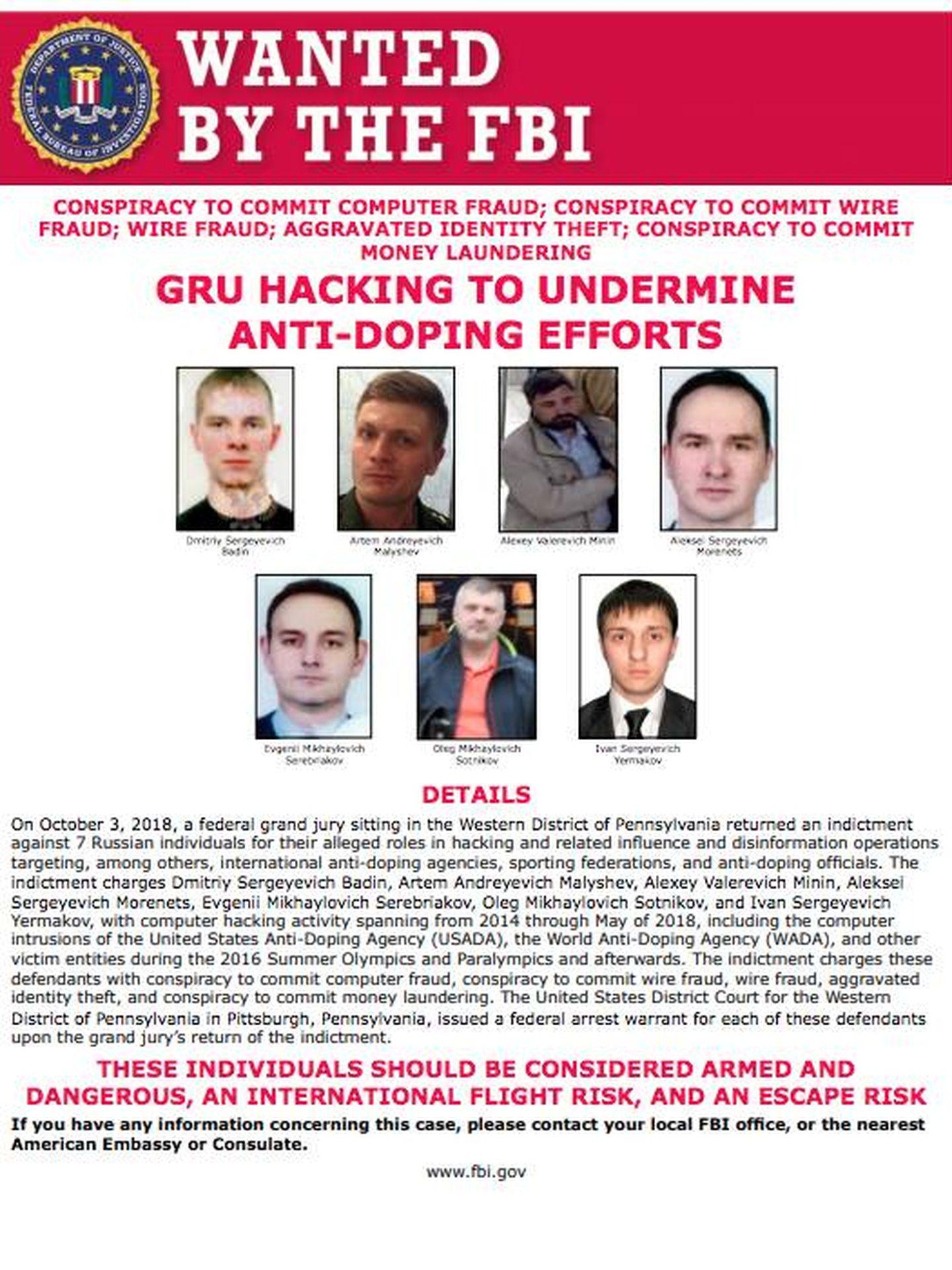 El cartel de 'se busca' con las caras de los siete supuestos espías rusos. (Departamento de Justicia de Estados Unidos)
