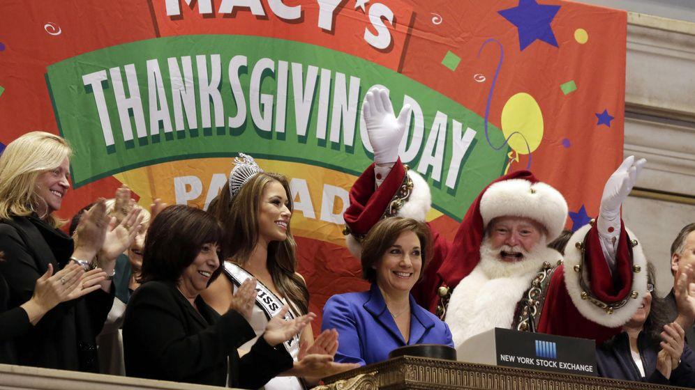 Foto: Miss EEUU y Santa Claus abren la sesión de la bolsa de Nueva York. (AP)