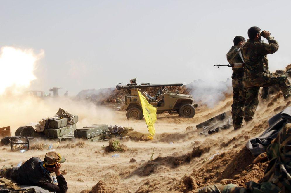 Foto: Milicianos chiíes del grupo Hashid Shaabi durante combates contra el ISIS en el frente de Bashir, al sur de Kirkuk (Reuters).