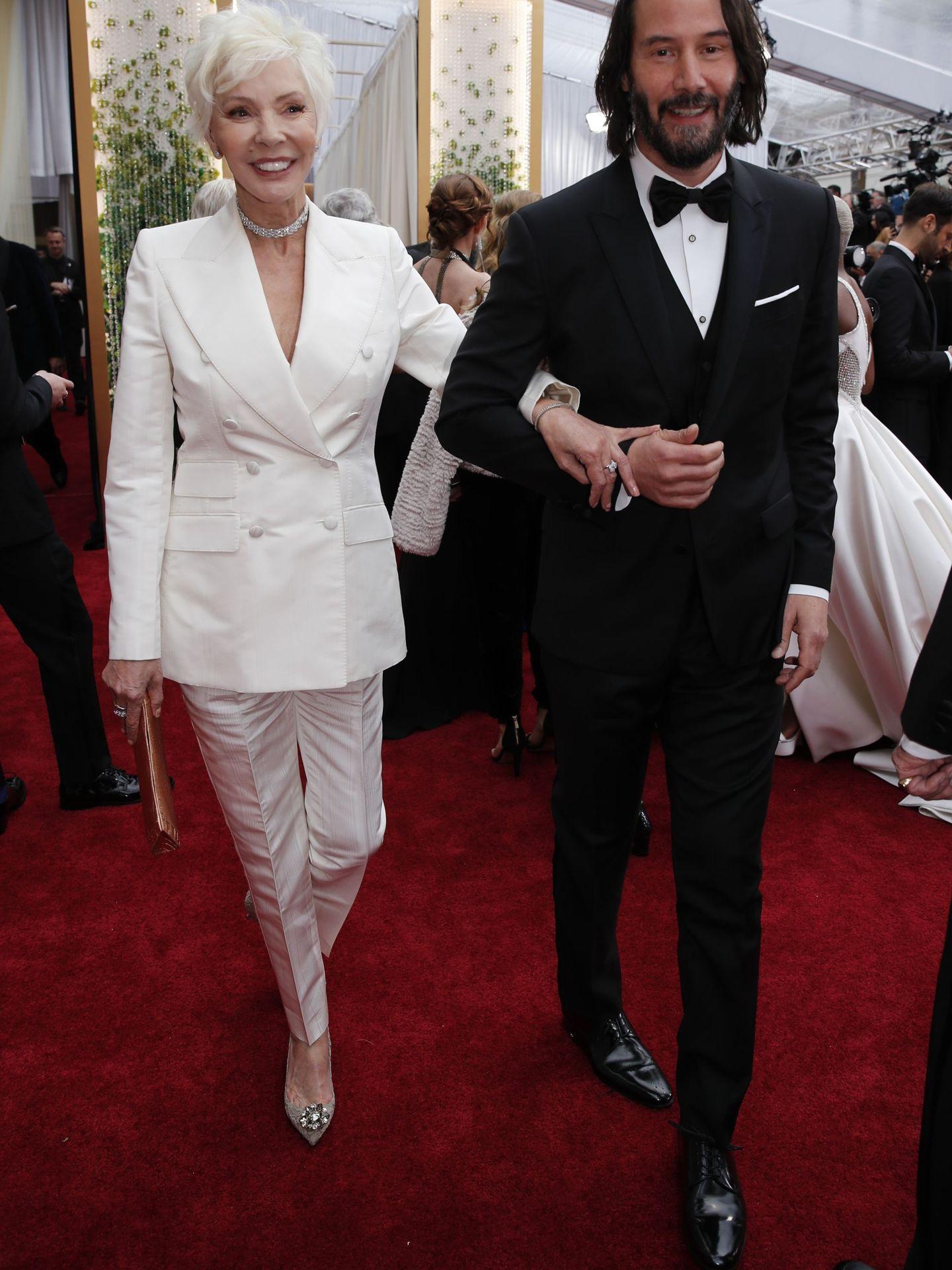 Con su madre en la alfombra roja. (Reuters)