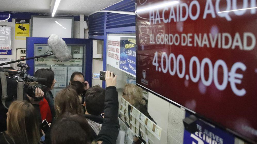 Foto: El número 66.513, premiado con el Gordo, premiado en Madrid en 2016 (EFE)