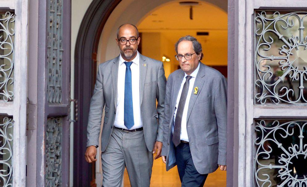 Foto: El consejero de Interior Miquel Buch (i) y Quim Torra, president de la Generalitat. (EFE)