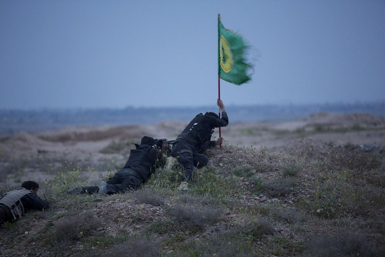 Foto: Milicianos chiíes durante combates contra el ISIS en Tikrit, Irak, en marzo de 2015 (Reuters).