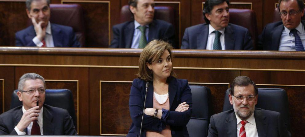 Foto: Santamaría (c), Rajoy (d) y Ruiz-Gallardón (i). (EFE)