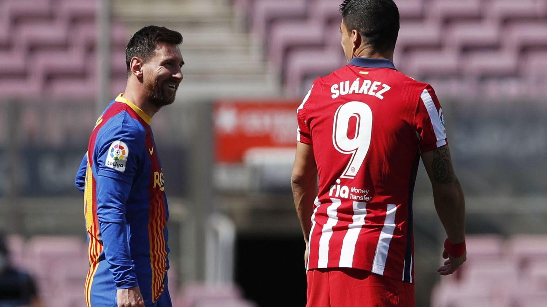 Messi junto a Luis Suárez en un partido entre el Barcelona y el Atlético. (EFE)