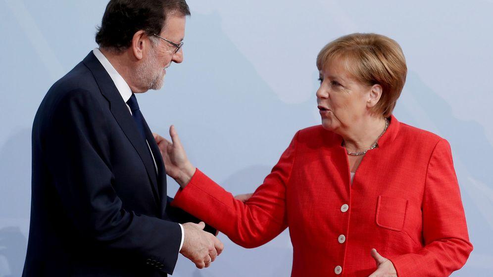 Foto: Mariano Rajoy, junto a Angela Merkel, en un encuentro europeo. (Foto: Reuters)
