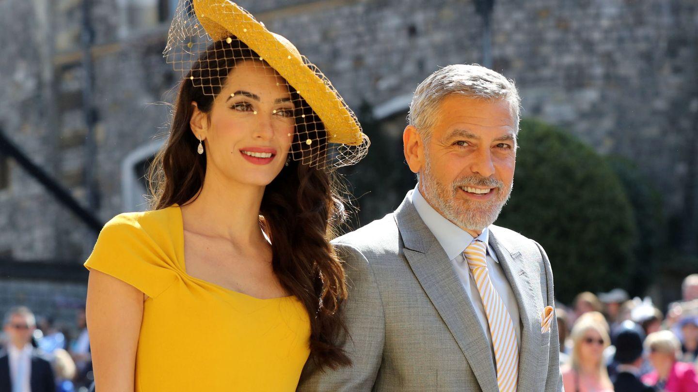 George y Amal Clooney, a su llegada a la capilla de San Jorge para asistir a la boda de Harry y Meghan. (Reuters)