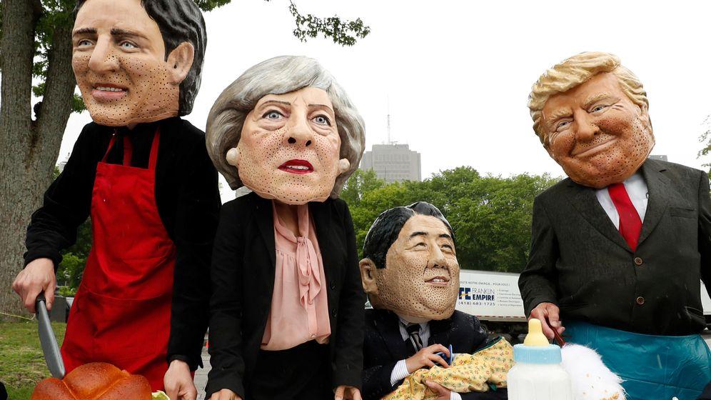 Foto: Protesta de activistas con máscaras de los líderes del G7. (Reuters)