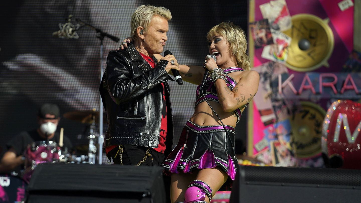 Feb 7, 2021; Tampa, FL, USA; Miley Cyrus, right, and Billy Idol perform on before the Kansas City Chiefs play the Tampa Bay Buccaneers in Super Bowl LV, Sunday. Feb. 7, 2021, in Tampa, Fla.  Mandatory Credit: Doug Benc Handout Photo via USA TODAY Sports