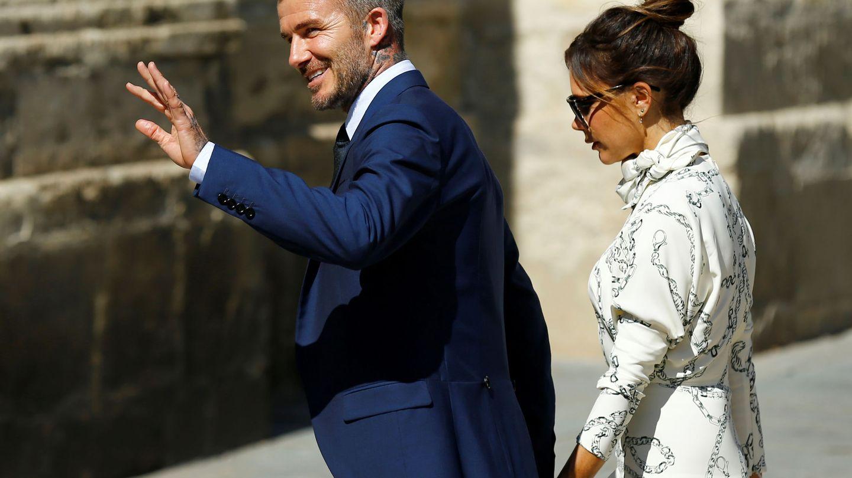 David Beckham y Victoria durante el enlace. (Reuters)