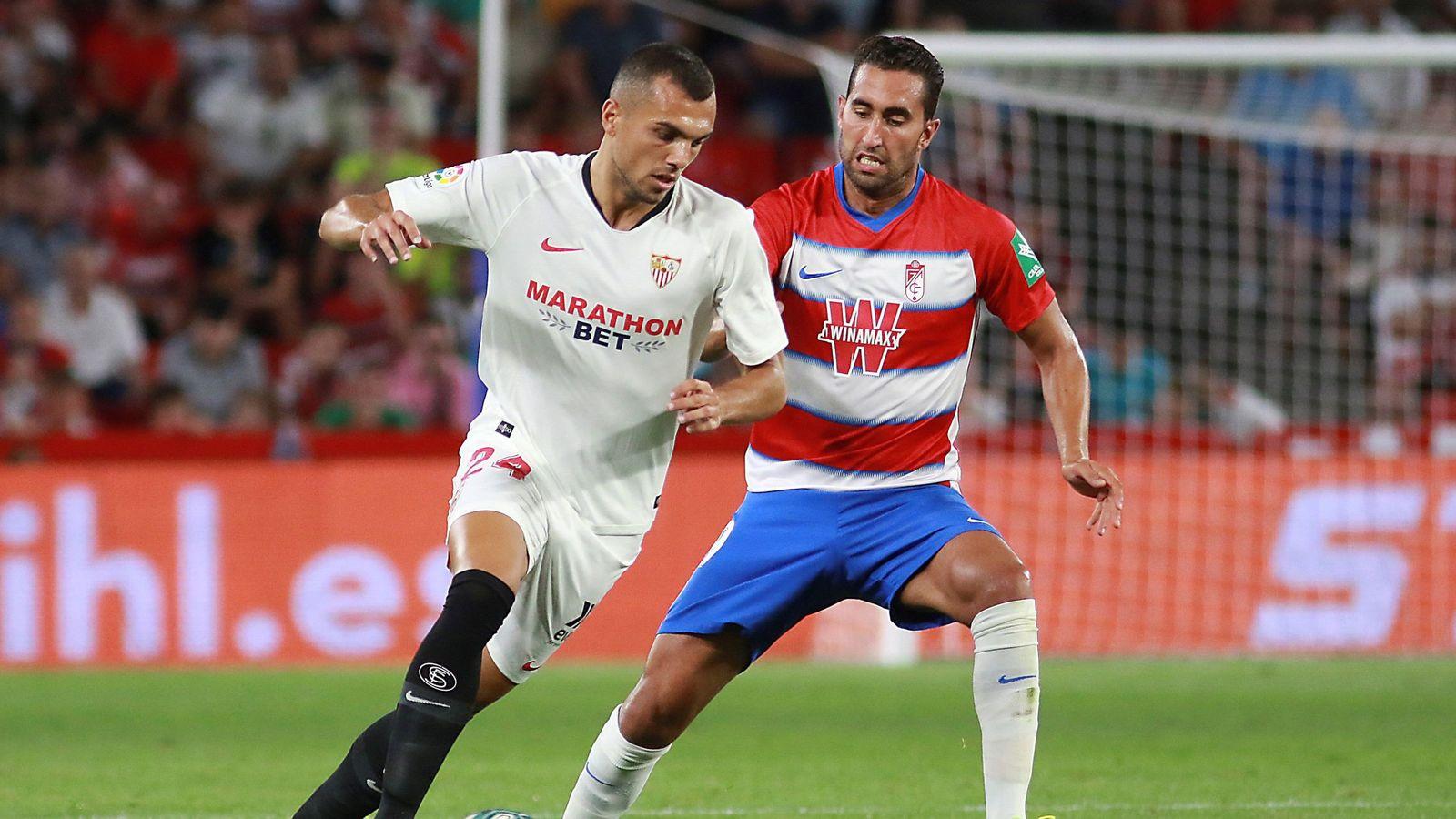 Foto: Joan Jordán marcó el gol de la victoria del Sevilla en Granada. (EFE)