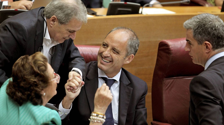 Alfonso Rus, con Barberá, Camps y Ricardo Costa. (EFE)