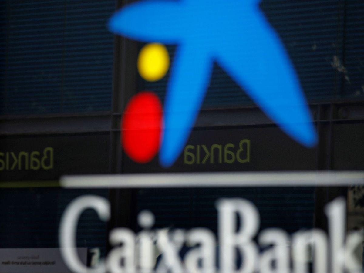 Foto: Los equipos de CaixaBank y Bankia trabajan contrarreloj para anunciar fusión. (EFE)