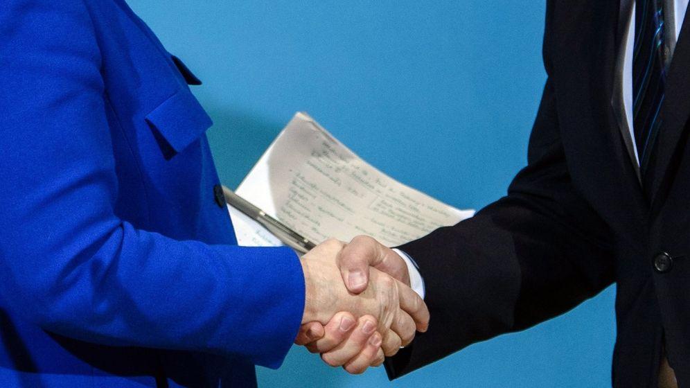 Foto: Merkel y Schulz confirman un preacuerdo para una gran coalición. (EFE)
