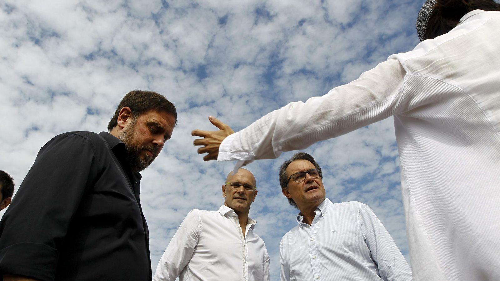 Foto: Los candidatos de Junts pel Sí Artur Mas (d), Oriol Junqueras (i) y Raül Romeva (c). (EFE)
