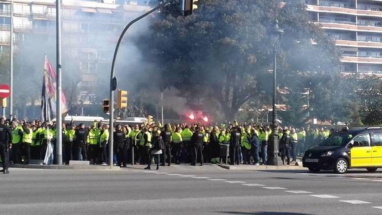 Acto de Rajoy en Cataluña: estibadores se concentran ante el Palau como protesta
