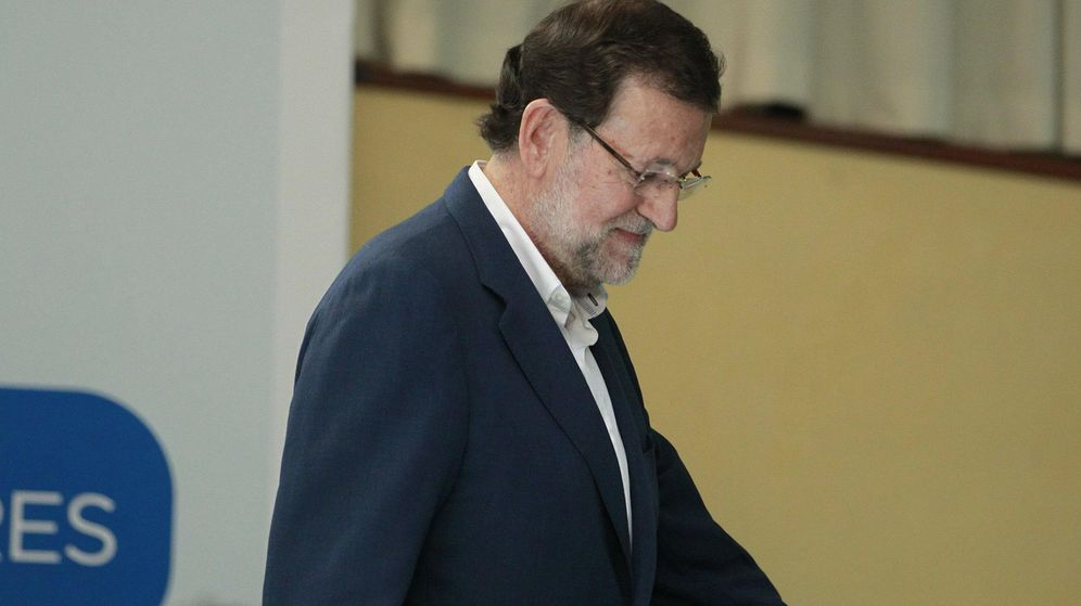 Foto: Rajoy tras suspender el mitin (Efe).