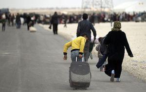Coches de lujo en la frontera: los ricos de Damasco huyen de Siria