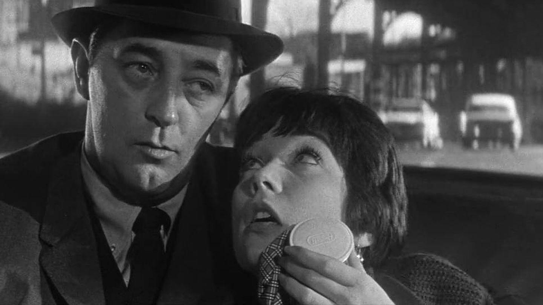 Robert Mitchum y Shirley MacLaine en 'Cualquier día en cualquier esquina'.  (1962)