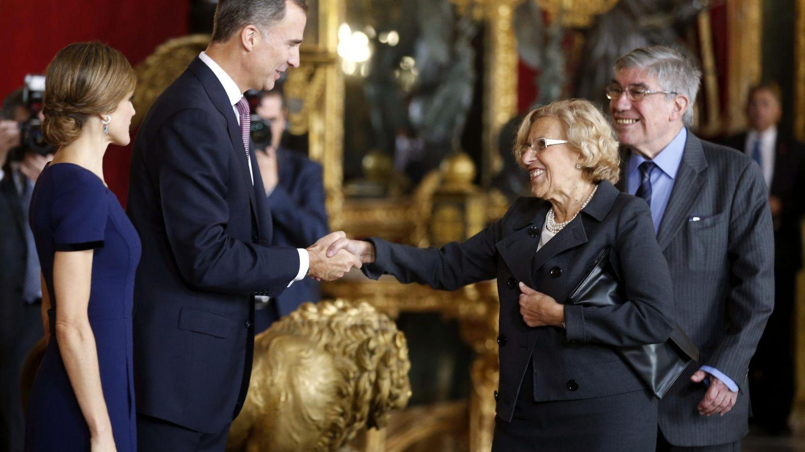 Foto: Eduardo Leira y Manuela Carmena, en un acto oficial en el Palacio Real. (EFE)