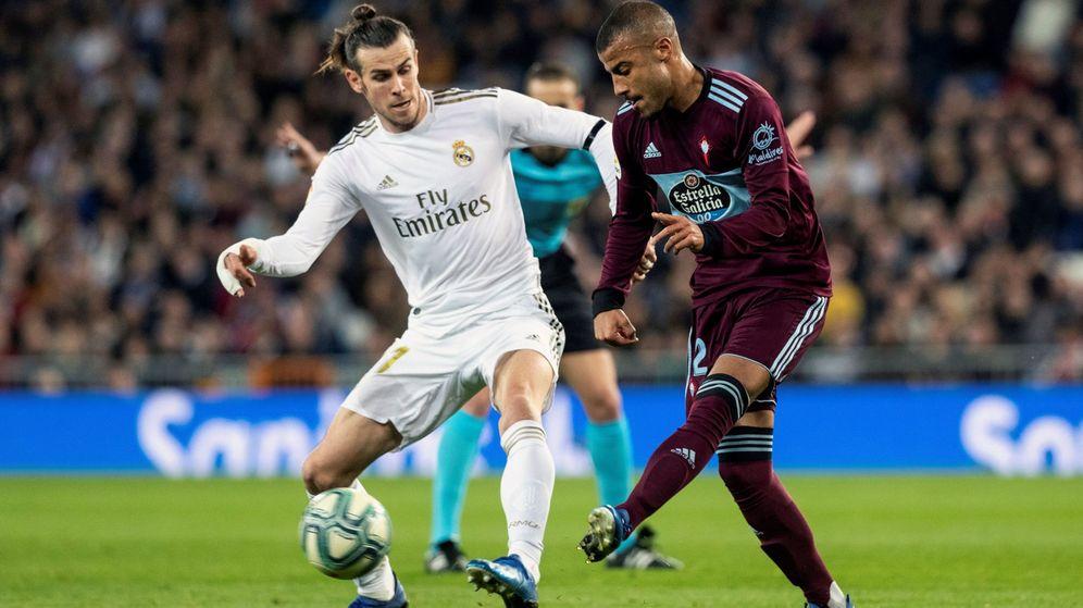 Foto: Gareth Bale pelea por un balón con Rafinha en el partido contra el Celta en el Bermabéu. (Efe)