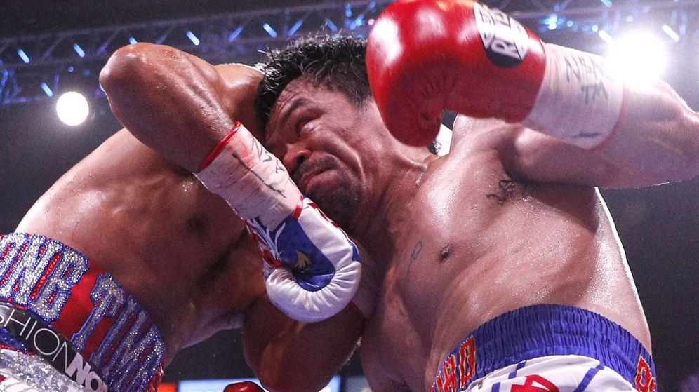 Foto: Manny Pacquiao (d) durante su pelea contra Keith Thurman. (EFE)