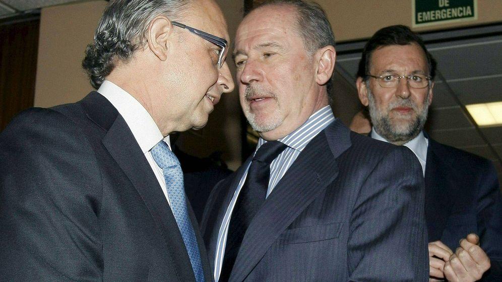Foto: Cristóbal Montoro, Rodrigo Rato y Mariano Rajoy. (Efe)