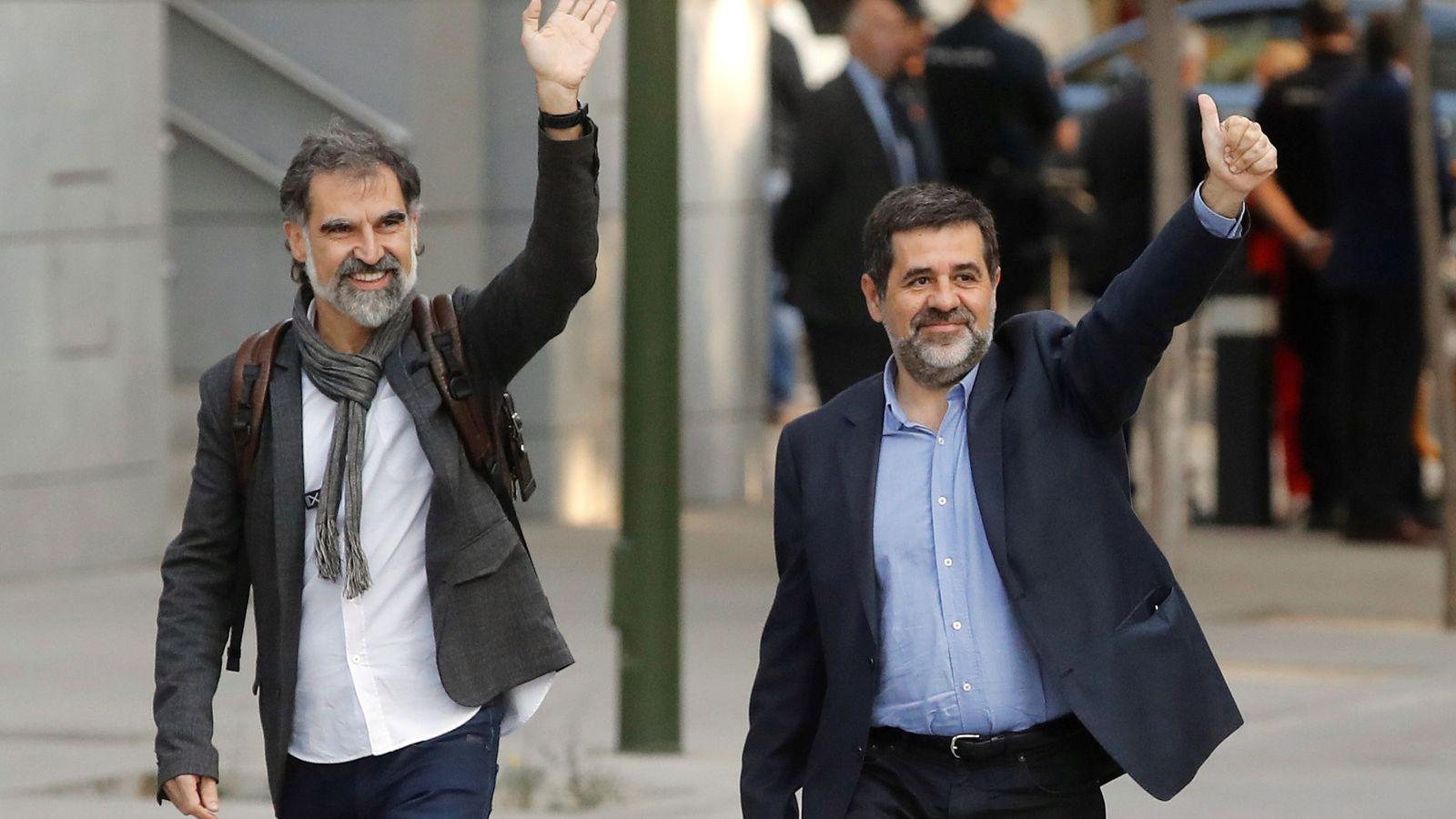 Foto: Jordi Sànchez y Jordi Cuixart a su llegada hace un año a la Audiencia Nacional. (EFE)