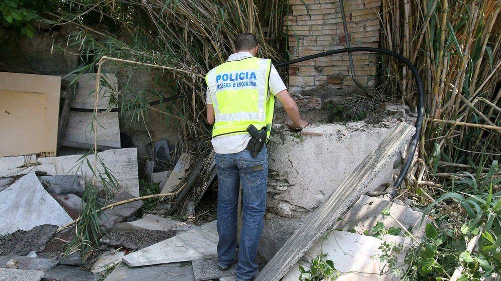 Foto: Búsqueda de los cuerpos de los asesinados por Ramón Laso. (EFE)