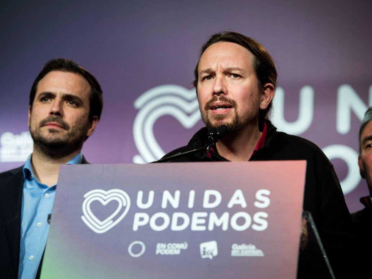 Foto: El secretario general de Unidas Podemos, Pablo Iglesias, comparece junto al líder de IU, Alberto Garzón, durante la noche electoral. (EFE)