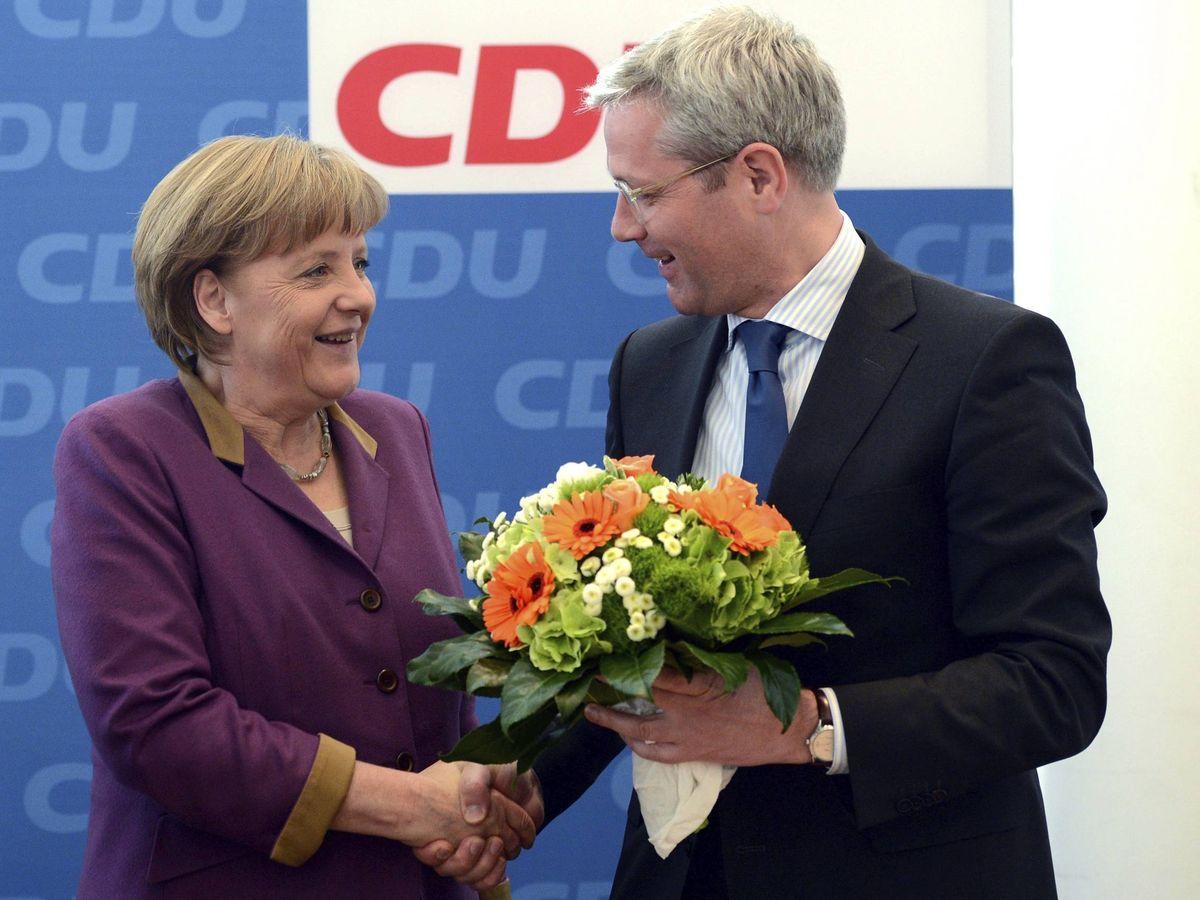 Foto: Norbert Röttgen y Angela Merkel, en una imagen de archivo de 2012. (EFE)