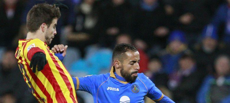 Foto: Piqué, durante el partido Getafe-Baarcelona (EFE)