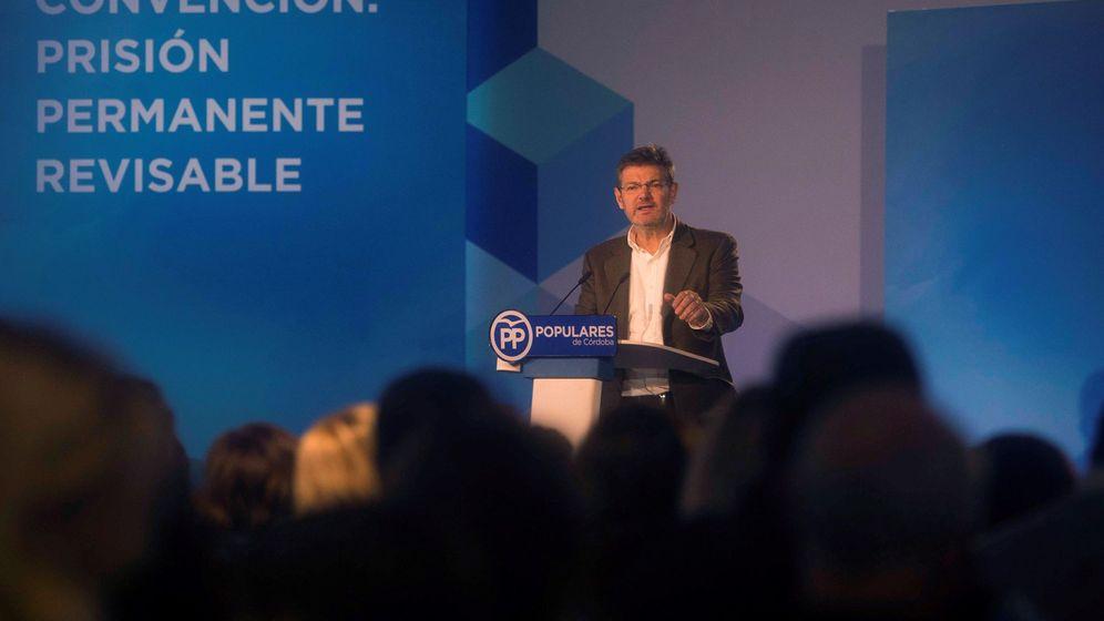 Foto:  El ministro de Justicia, Rafael Catalá, interviene en la Convención Nacional del PP sobre la prisión permanente revisable. (EFE)