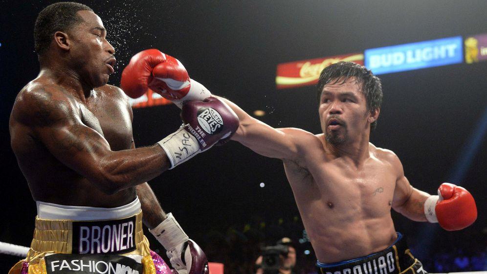 Foto: Pacquiao retuvo el cinturón del peso welter versión Asociación Mundial de Boxeo. (USA Today Sports)