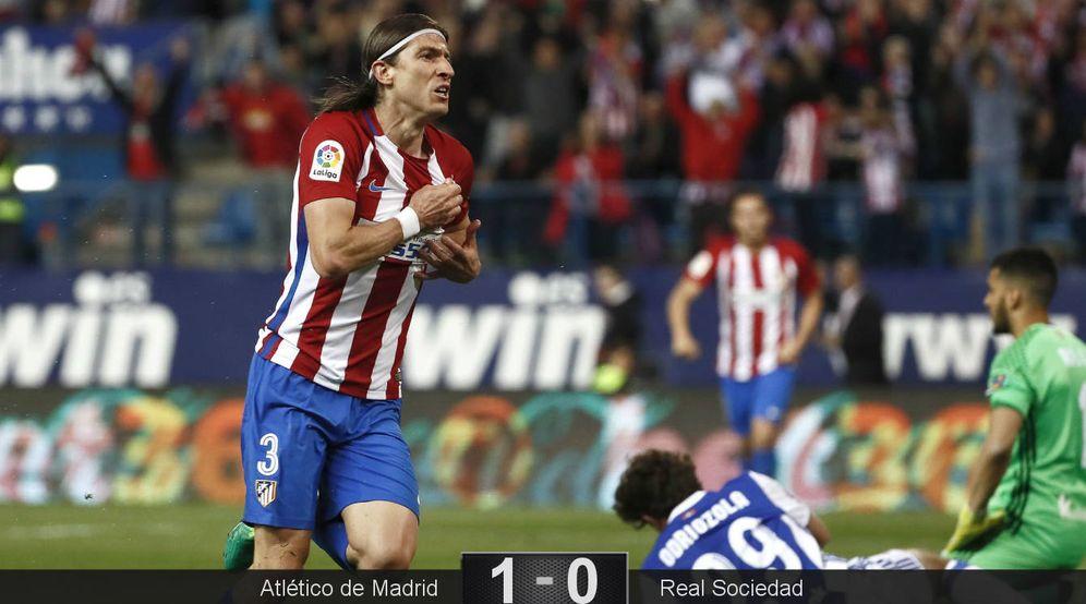 Foto: Filipe Luis celebra el gol que dio los tres puntos al Atlético de Madrid. (EFE)