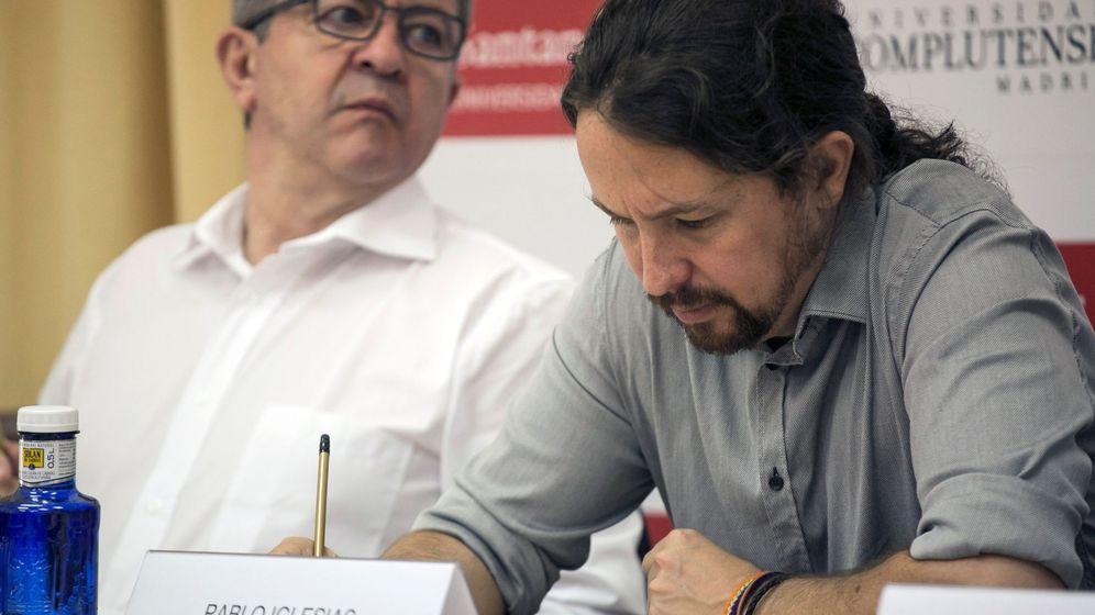 Foto: Pablo iglesias y Jean-Luc Mélenchon, durante su participación en un curso de verano de la Universidad Complutense el pasado mes de julio. (EFE)